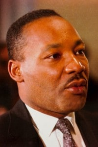 A 1966 photograph of Martin Luther King Jr, cropped to include only his head and shoulders
