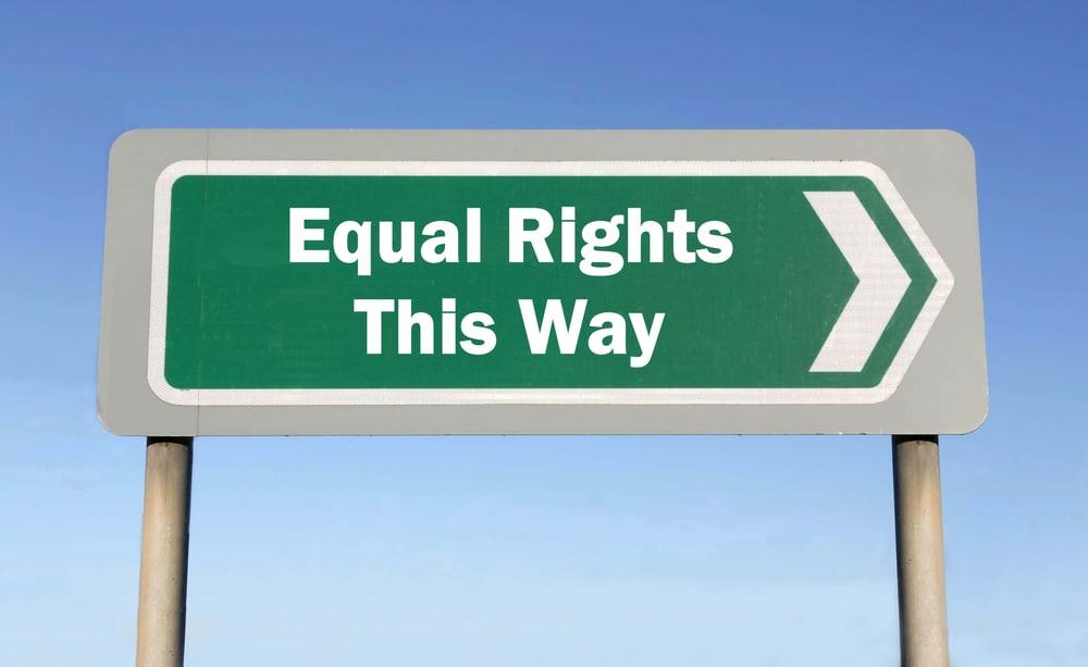 "Green road sign saying ""Equal Rights This Way"""